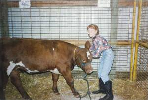 Me and Freckle. She was the best heifer I ever showed.