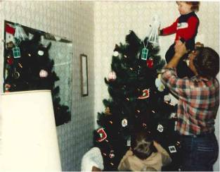 Christmas 1985. The last year that I got to put the angel on the tree because then Bek was born. :)